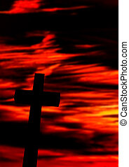 Cross against a red dramatic sky - Conceptual image of the...