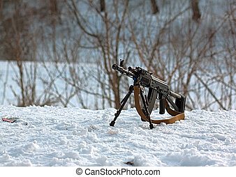 gun AK-47 - machine gun AK-47 located on a snow