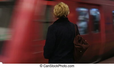 waiting train - woman waiting subway on the station,...