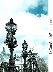 Pont Alexandre III is an arch bridge that spans the Seine,...