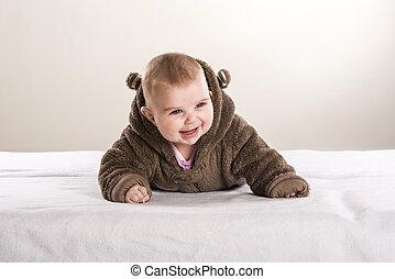 Little baby - Sweet little baby is lying on mattress in...