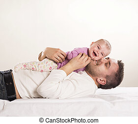 Father with child - Young father is having fun with his...
