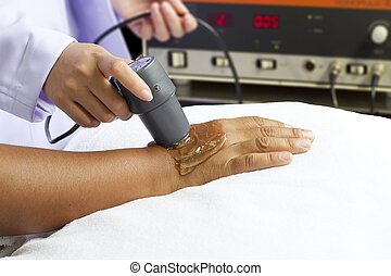 woman getting physical therapy,ultrasound - woman getting...