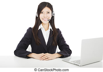 Young  smiling businesswoman with headset and laptop