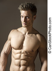 Blond athetic man - Blond athletic man with well developed...