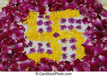 Rose petals swastika rangoli decoration Ikebana