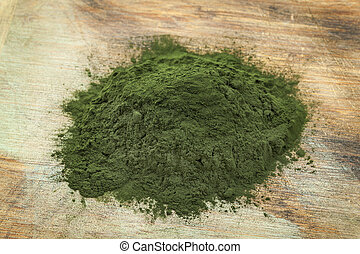 Hawaiian spirulina powder - a pile of Hawaiian spirulina...