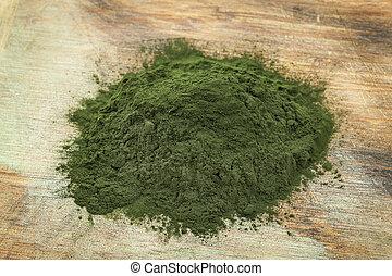 Hawaiian spirulina powder - a pile of Hawaiian spirulina...