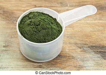 Hawaiian spirulina powder - measuring scoop of Hawaiian...