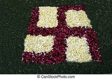 Rose petals swastika rangoli decoration