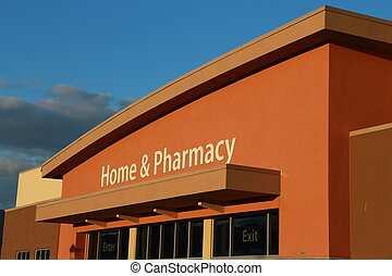Home and pharmacy sign on building with sunset light