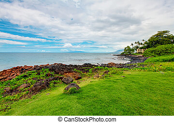 Maui. Hawaii. Tropical shore with resort buidling.