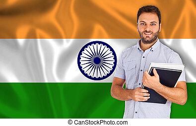 Hindi language - Young smiling student learns the hindi...