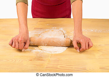 Rolling dough - Female hands rolling a piece of homemade...