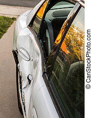 Dented up door - Door of a car dented up due to an auto...