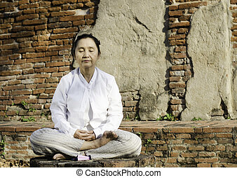 Buddhist woman in meditation - Buddhist woman meditating...