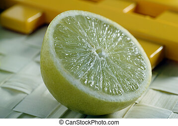 Lemon Slice - A closeup shot of a yellow isolated Lemon...