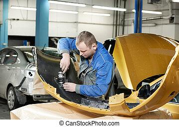 repairman grinding metal body car - professional repairman...