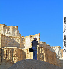 The tourist photographs in a canyon of the Dead Sea.