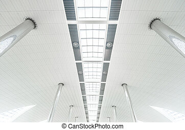 Metal columns and modern glass ceiling at airport.