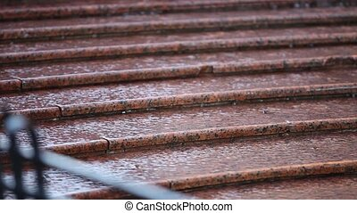 rain at the steps - water runs down the steps...