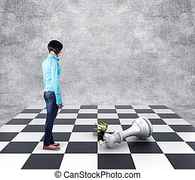 Chess - Girl standing before the lost king on a chessboard