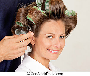 Client With Hairdresser Rolling Her Hair - Portrait of...