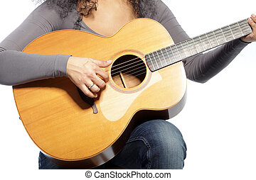 Guitar - Close up shot of unrecognizable woman playing...