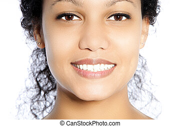 Toothy smile - Beautiful face of an African American woman...