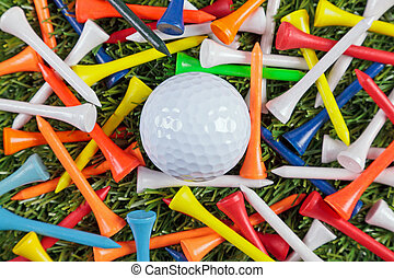 Golf ball and wooden tees collection - A golf ball amongst a...