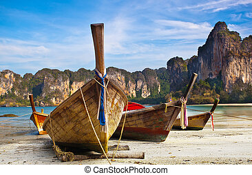 Longtail boats - Traditional longtail boats in bay of...