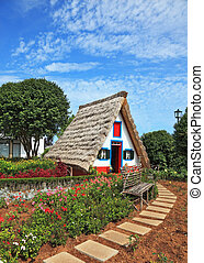 Charming cottage and small garden with flowers
