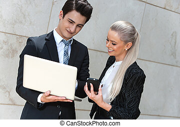 Business couple reviewing data. - Portrait of young business...