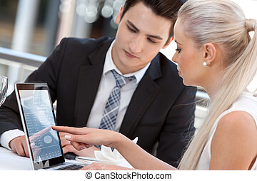 Businesswoman showing work to partner - Close up portrait of...