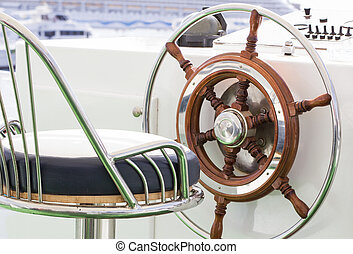 Yacht rudder - Closeup of rudder and chair in a luxury boat.