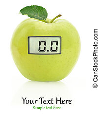 Digital weight scale on a green apple