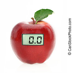 Digital weight scale on red apple