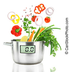 Fresh vegetables falling into a casserole pot with digital...