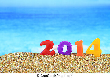 Multicolored new year 2014 on the beach