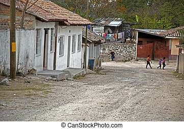 Street in late afternoon, Ojojona, Honduras. - Typical...