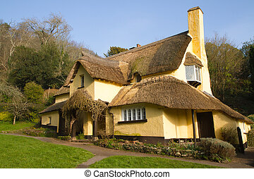 Thatched cottage English village - Thatched cottage in an...