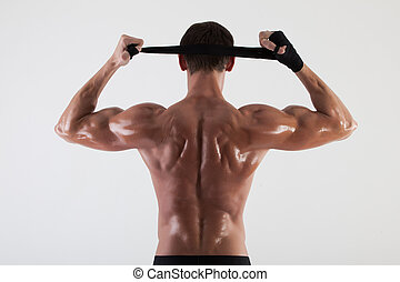 The muscular male back on white background isolated