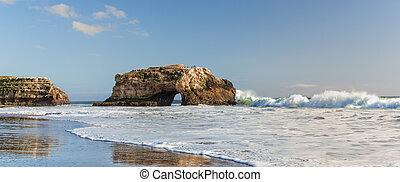 Panorama of Natural Bridges State Beach - Arches at Natural...