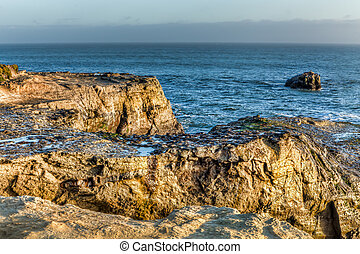 Sunlit Rocks at Natural Bridges State Beach - Natural...