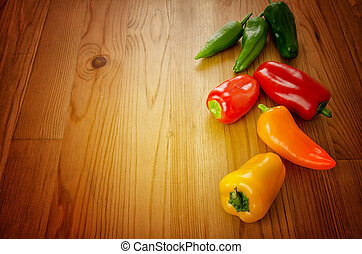 Peppers on wooden background