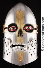 helmet - A crusader helmet with human eyes and a silver...