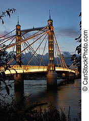 Albert Bridge in London, crossing the Thames River between...