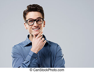 Smart man with glasses looking up