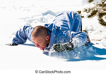 Bald boy licking the snow - Bald boy in hood licking the...