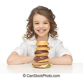 little girl with junk food - picture of beautiful little...